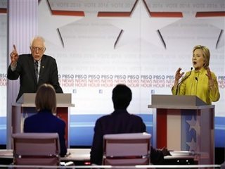 Clinton and Sanders clash over minorities, Obama