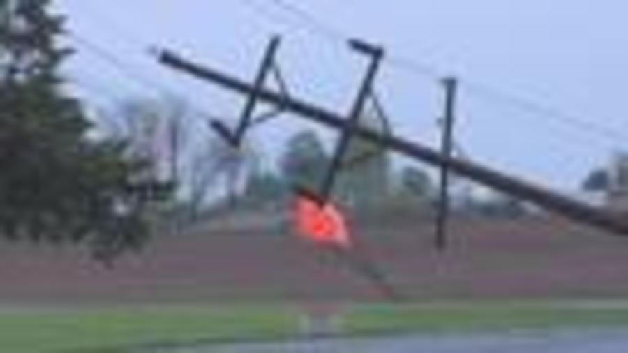 Straight-line winds knock entire row of power lines over in Indianapolis