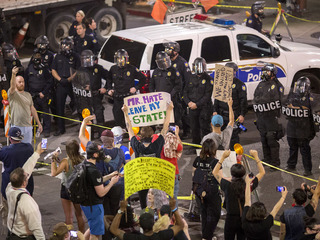Cops use tear gas outside Trump's Phoenix rally