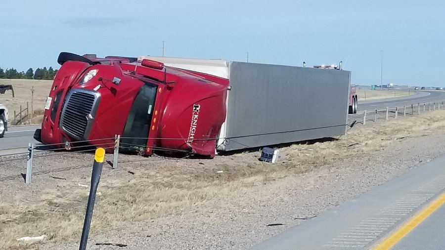 High winds topple more than a dozen semi-trucks in Wyoming- Colorado
