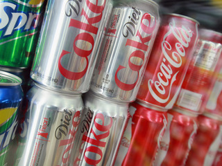 How healthy is it to drink 12 Diet Cokes a day?