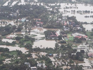 Kerala rescue teams wade through filthy waters