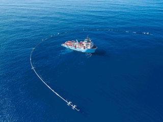 Floating pipe begins plastic cleanup of ocean