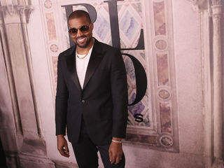 Kanye West donates $150K for guard killed by cop